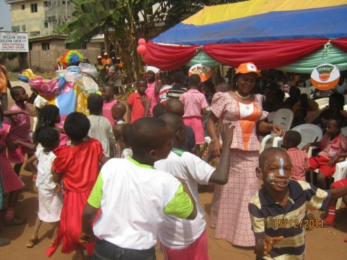 Bina founder dancing with the children during the event