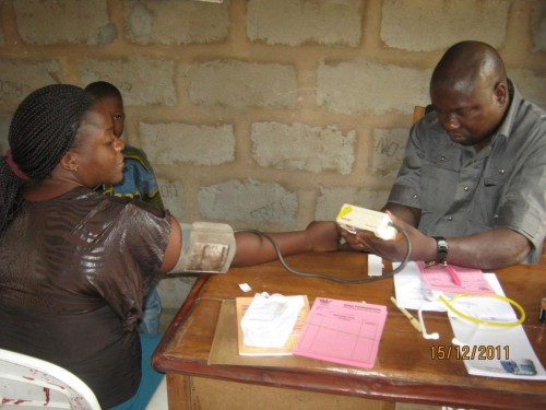Bina volunteer doctor examining the patients B.P during the event