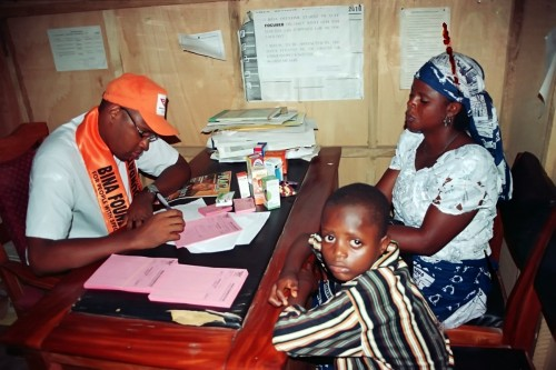 One of the Bina Foundation Medical doctors attending to one of the patients