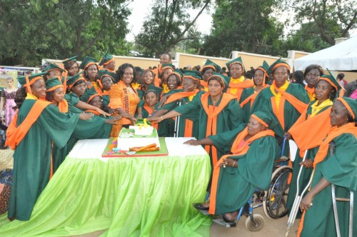 The President with the graduands during presentation and cutting of cake