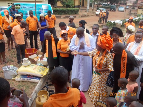 The president of bina foundation presenting food items to the motherless babies